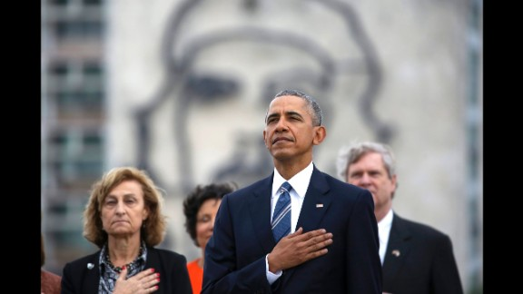 Backdropped by a monument depicting revolutionary hero Che Guevara, Obama listens to the U.S. national anthem during the wreath-laying ceremony on March 21.