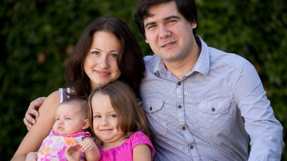 In this 2014 file photo, Vadym Kholodenko poses with his wife Sofya Tsygankova and daughters Nika, 4, and Michela, 2 months old.