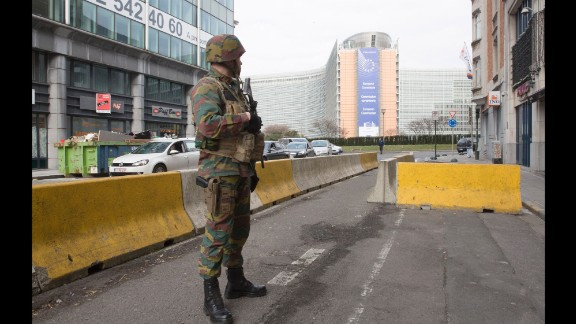A Belgian soldier stands guard at the Berlaymont building, the headquarters of the European Commission, Tuesday morning after an explosion near the Maalbeek subway station.
