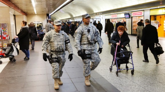Members of the New York National Guard patrol Penn Station Tuesday morning following explosions at the airport and subway system in Brussels.