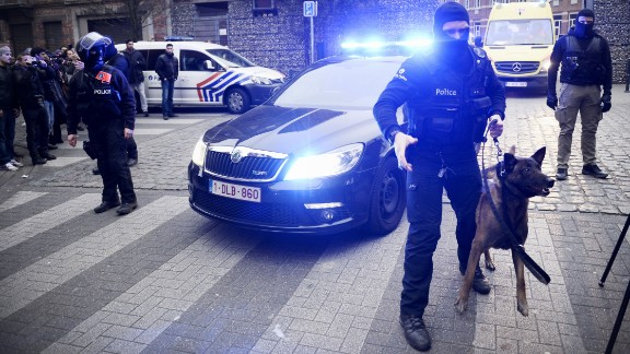 Policemen block a road, near the scene of a police raid in the Molenbeek-Saint-Jean district in Brussels, on March 18, 2016, as part of the investigation into the Paris November attacks.