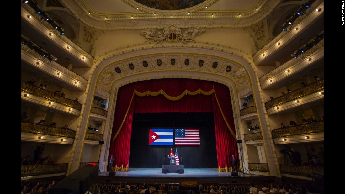 "Obama waves to the crowd before delivering his speech at the Grand Theater in Havana on March 22. In his speech, Obama urged Cubans to look to the future with hope, casting his historic visit as a moment to ""bury the last remnants of the Cold War in the Americas."""