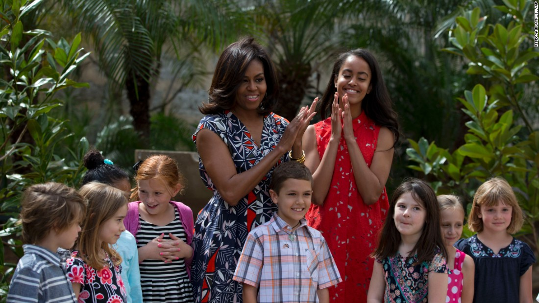 First lady Michelle Obama and her daughter Malia stand with children of U.S. Embassy workers after dedicating a bench and two magnolia trees at a small park in Havana on March 22.