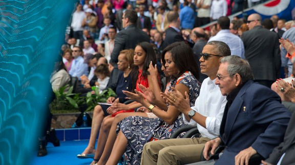 U.S. President Barack Obama attends a baseball game in Havana, Cuba, with his family and Cuban President Raul Castro, right, on Tuesday, March 22. The Cuban national team was playing an exhibition against Major League Baseball