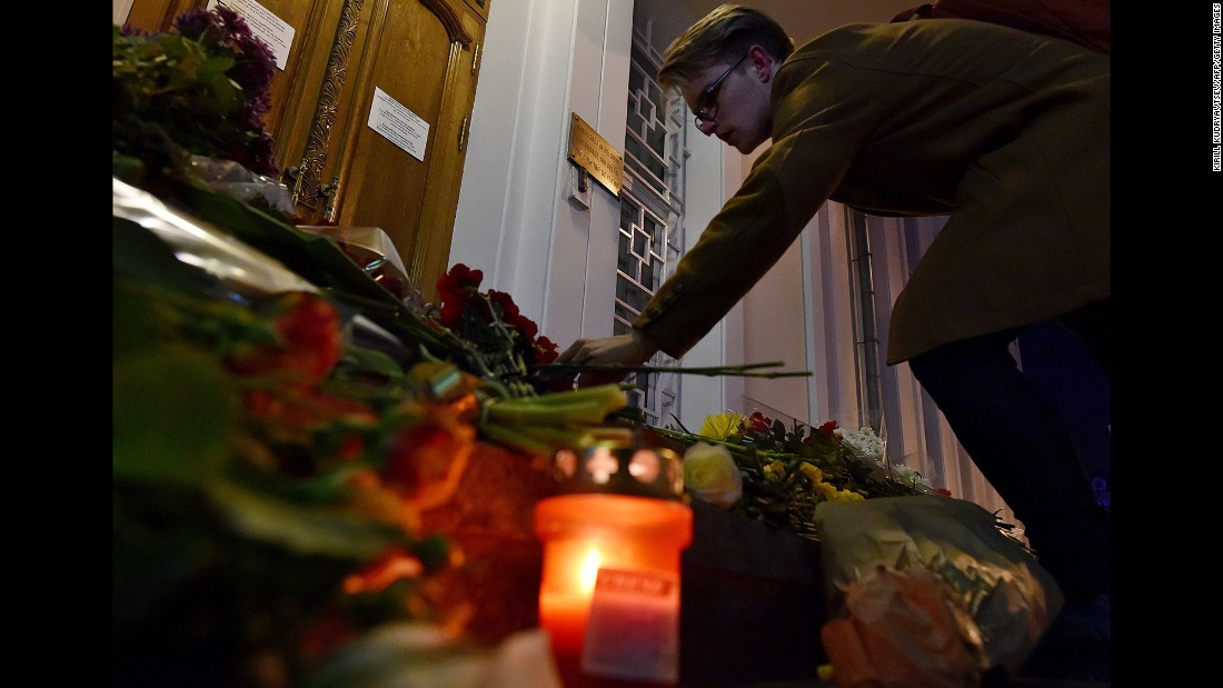 A man places flowers outside the Belgian Embassy in Moscow on March 22.