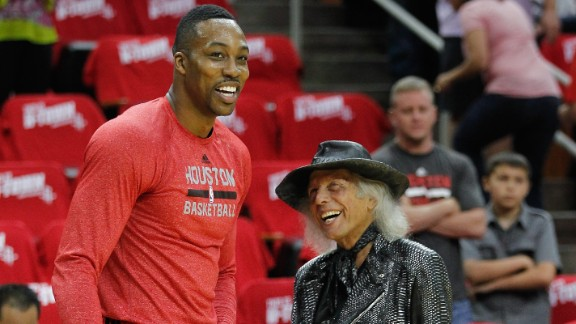 """Known as """"Jimmy"""" to his friends, Goldstein likes to arrive at NBA games 45 minutes before tipoff to socialize with players, many of whom he calls friends. He is pictured here with Dwight Howard of the Houston Rockets before a 2014 Western Conference playoff game in Houston, Texas."""