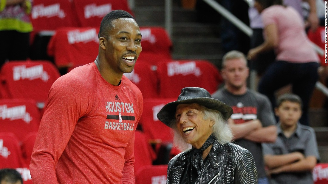 "Known as ""Jimmy"" to his friends, Goldstein likes to arrive at NBA games 45 minutes before tipoff to socialize with players, many of whom he calls friends. He is pictured here with Dwight Howard of the Houston Rockets before a 2014 Western Conference playoff game in Houston, Texas."