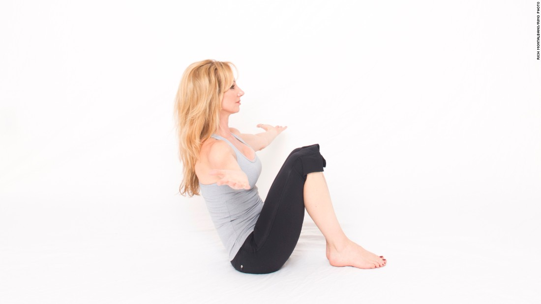 While seated on the floor, curl yourself into a ball with your feet on the floor. Keep your knees and feet together to engage adductors (groins) for hip and pelvic floor stability. Inhale as you reach your arms out to the sides, palms up, without letting your shoulders elevate. Exhale as you bring your arms together in front of you. Do three repetitions. Drop your knees out in a cobbler's or butterfly pose to release your groins and hips; if hip mobility is limited, additional hip-opening postures are recommended. Repeat for another set of three.