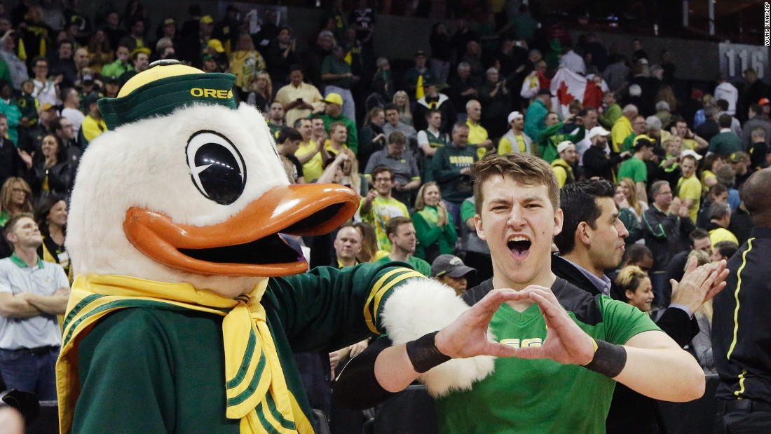 Oregon's mascot and cheerleaders celebrate after a victory on Sunday, March 20.