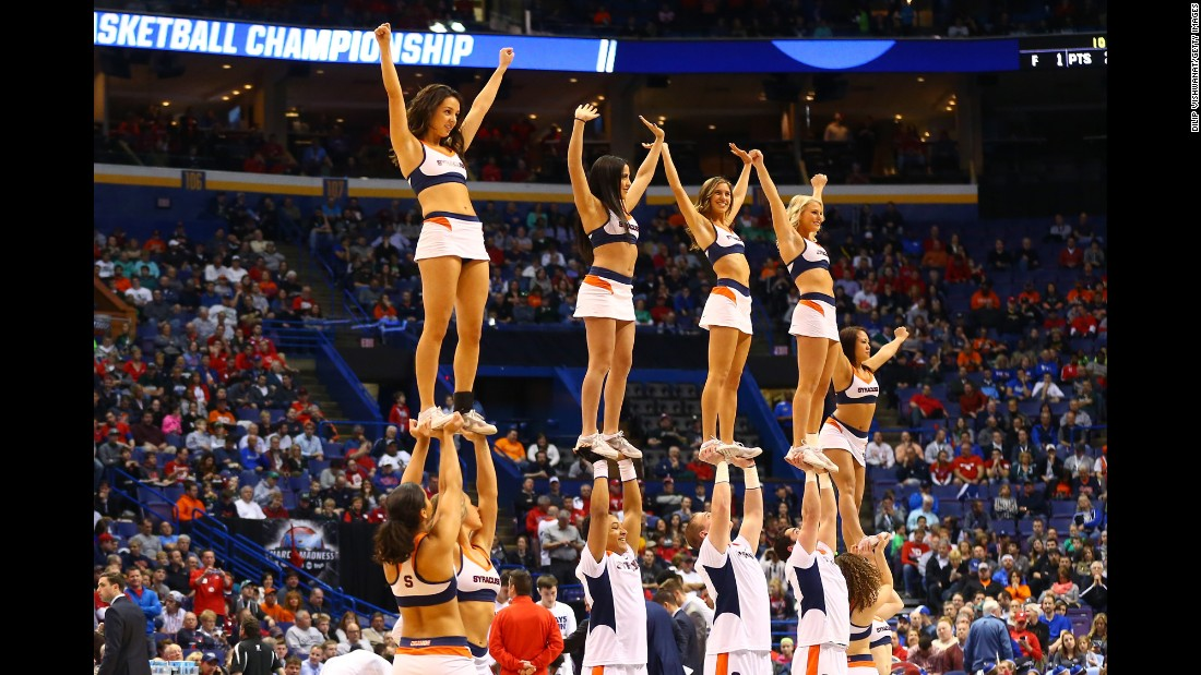 Syracuse cheerleaders perform during a first-round game on Friday, March 18.