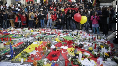 People gather on the Place de la Bourse in Brussels on March 23, a day after blasts hit the Belgian capital.