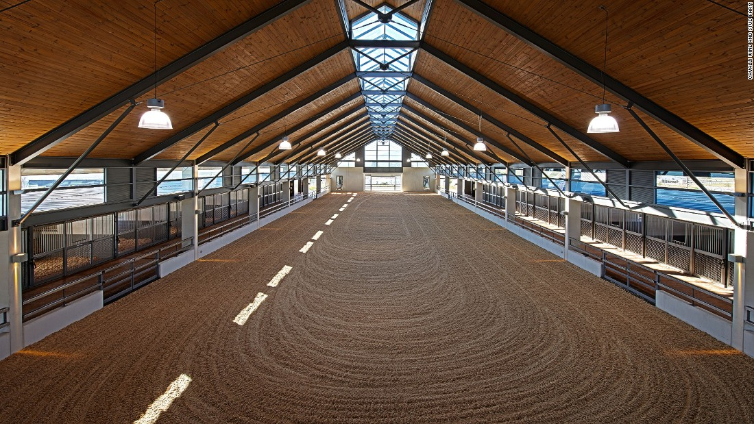 Equestrian facilities on the estate include an outdoor training center and this impressive indoor arena.