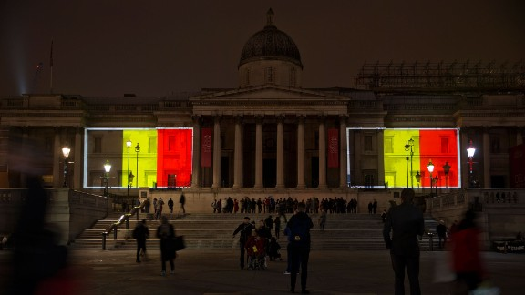 Belgian national flags are projected onto the National Gallery in London