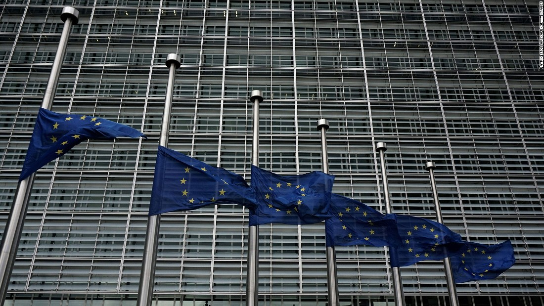 European Union flags fly at half-staff outside the European Commission in Brussels on March 23.