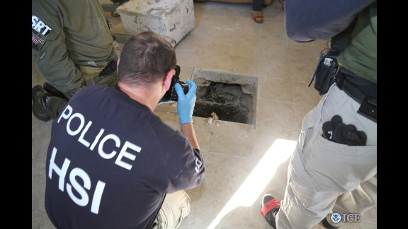 Federal agents photograph tunnel exit inside a house in Calexico, California.