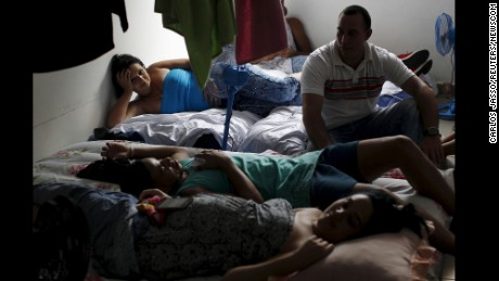 Cuban migrants rest in an old hotel used as a provisional shelter in Paso Canoas, Panama, on March 20.