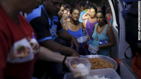 Cuban migrants queue for donated food at a provisional shelter in Paso Canoas, Panama, on March 20.