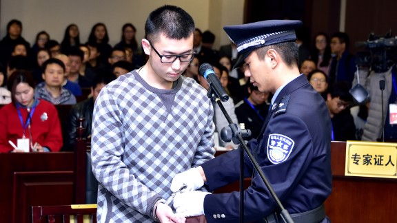 Li Xiangnan stands trial at the Intermediate People's Court on Wednesday in the eastern Chinese city of Wenzhou on Wednesday, March 23.