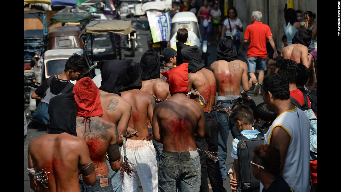 Penitents flagellate themselves as part of Holy Week celebrations in Manila, Philippines, on March 24.