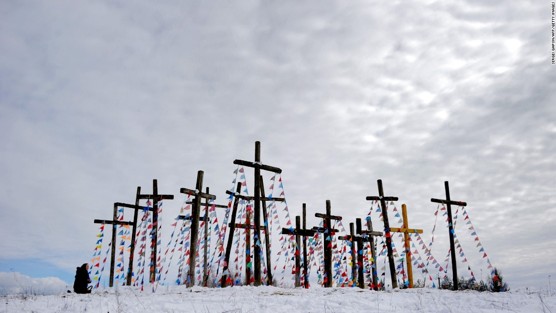 A woman prays on a hill in Oshmiany, Belarus, on Sunday, March 20.