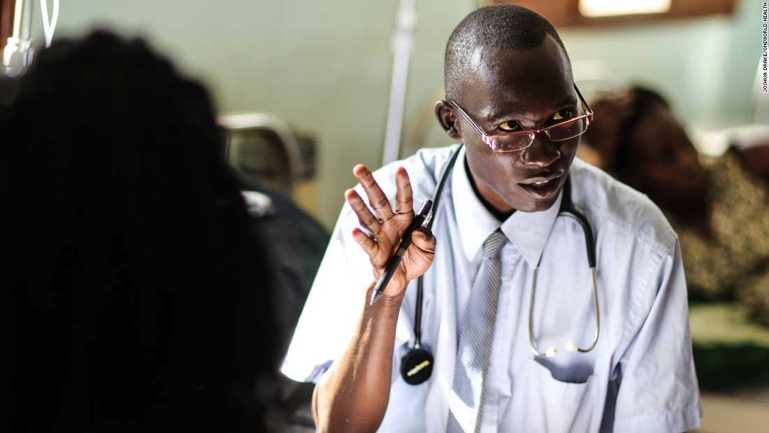 Dr. Dan consults with a patient at the Masindi Kitara Medical Center before an exam.
