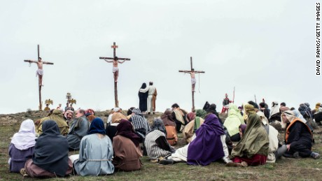 Actors in Hiendelaencina, Spain, reenact the crucifixion of Jesus.