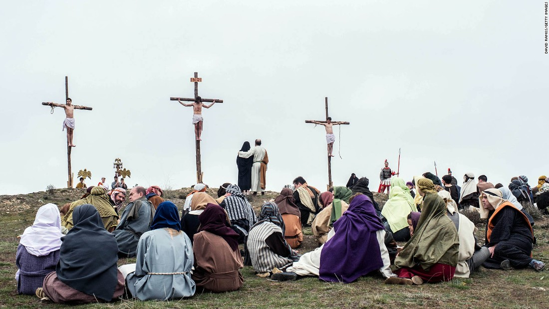 An actor portraying Jesus is crucified as residents of Hiendelaencina, Spain, dress in period clothing to perform a re-enactment of Christ's suffering on March 25.