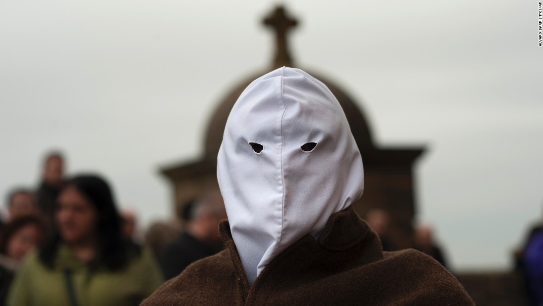 "A masked penitent from La Santa Vera Cruz brotherhood takes part in an Easter procession known as ""Los Picaos"" in the small village of San Vicente de La Sonsierra in northern Spain on March 25."
