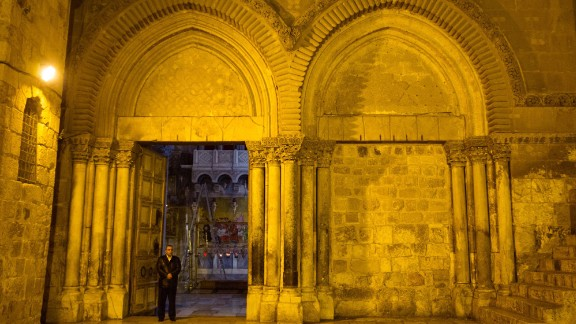 Adeeb Joudeh stands at the entrance to the Church of the Holy Sepulchre on Holy Thursday.