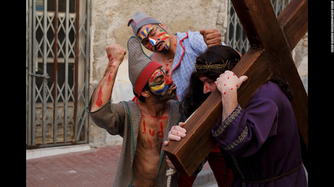 "Actors representing ""los Judios"" and Jesus Christ take part in ""La Judea"" along the streets of Cuevas del Almanzora, Spain, during a Holy Friday procession on Friday, March 25. Certain families in the city have kept this tradition alive for more than 100 years."