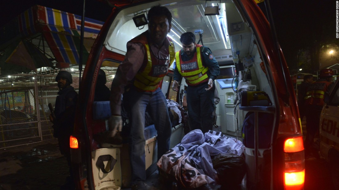 Rescuers load a victim into an ambulance.