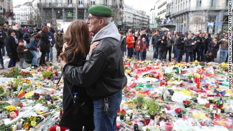 People gather on the on the Place de la Bourse in central Brussels on March 27 in a tribute to bombing victims.