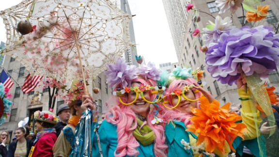 Two women pose for photographers as the parade makes its way down Fifth avenue.