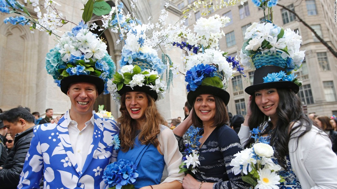 Tom Nickel, Allison and Adrian Devereux, and Jane Pastrana show off their floral-themed Easter clothes as they pose for photographers and members of the public.