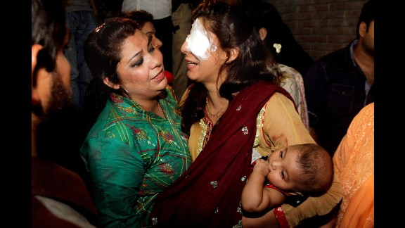 A woman injured in the bomb blast is comforted by a family member at a local hospital in Lahore on March 27.