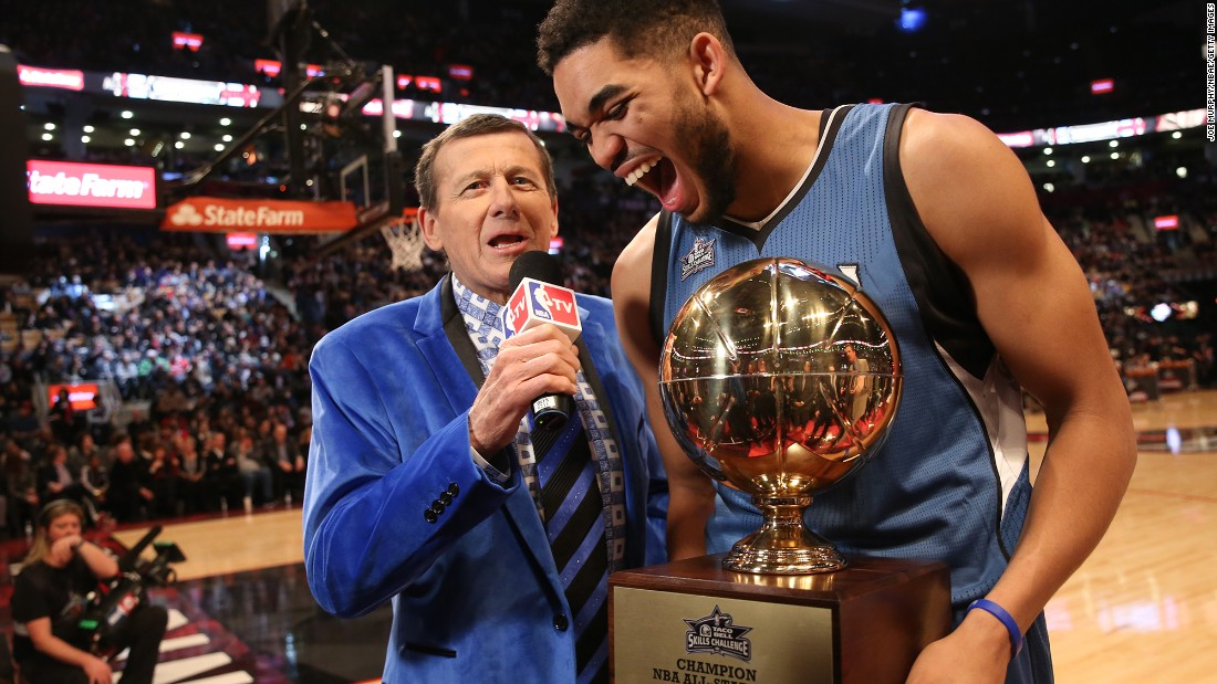 "Sager, in a blue velvet jacket, interviews Karl-Anthony Towns of the Minnesota Timberwolves during the 2016 NBA All-Star Game. ""Sports are supposed to be fun, and so I have fun with the way I dress,"" <a href=""http://bleacherreport.com/articles/2383247-craig-sagers-harrowing-and-emotional-journey-back-to-the-nba"" target=""_blank"">Sager said.</a>"