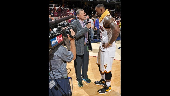 """Sager speaks with LeBron James after a Cleveland Cavaliers game in January 2016. """"Guys in the NBA really like him because he's fair,"""" former NBA great Charles Barkley told Bleacher Report about Sager. """"He'll ask tough questions, but they are fair questions."""""""
