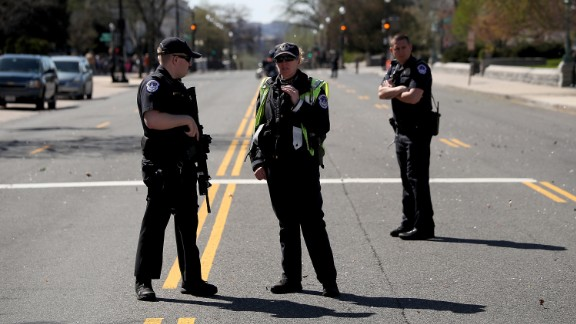 """WASHINGTON, DC - MARCH 28:  U.S. Capitol police stand guard outside the U.S. Capitol after at least one person was shot in the Capitol Visitor Center March 28, 2016 in Washington, DC. The Capitol was placed in """"lock down"""" following the shooting.  (Photo by Win McNamee/Getty Images)"""