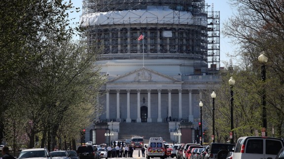 """WASHINGTON, DC - MARCH 28:  Emergency personnel and law enforcement officers gather outside the U.S. Capitol after at least one person was shot in the Capitol Visitor Center March 28, 2016 in Washington, DC. The Capitol was placed in """"lock down"""" following the shooting.  (Photo by Win McNamee/Getty Images)"""
