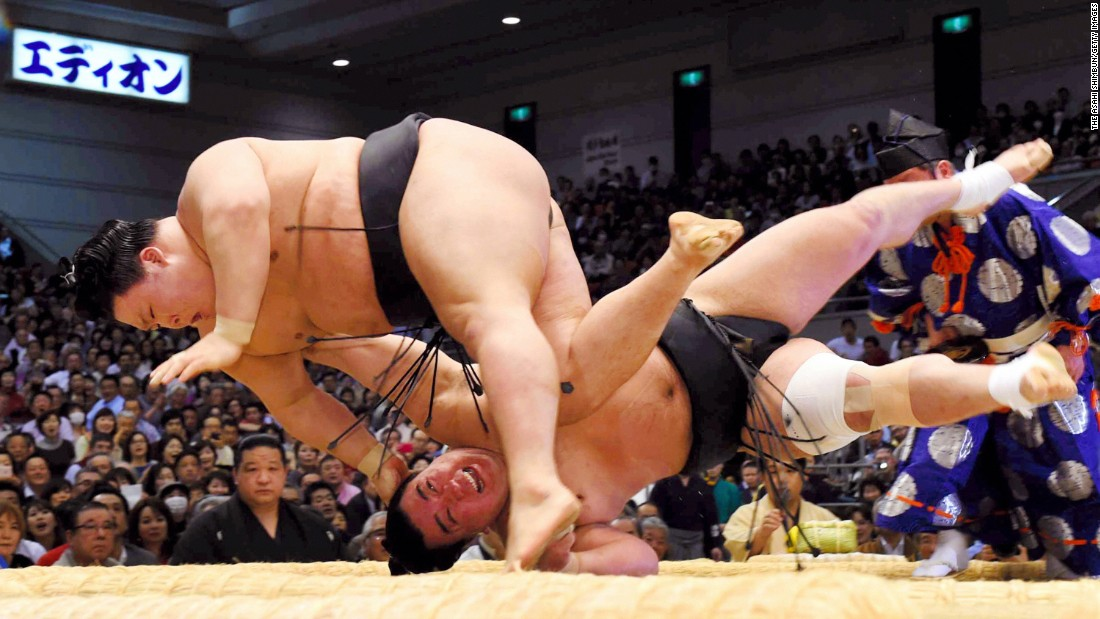 Goeido, above, throws Harumafuji to win a match Wednesday, March 23, at the Grand Sumo Spring Tournament in Osaka, Japan.