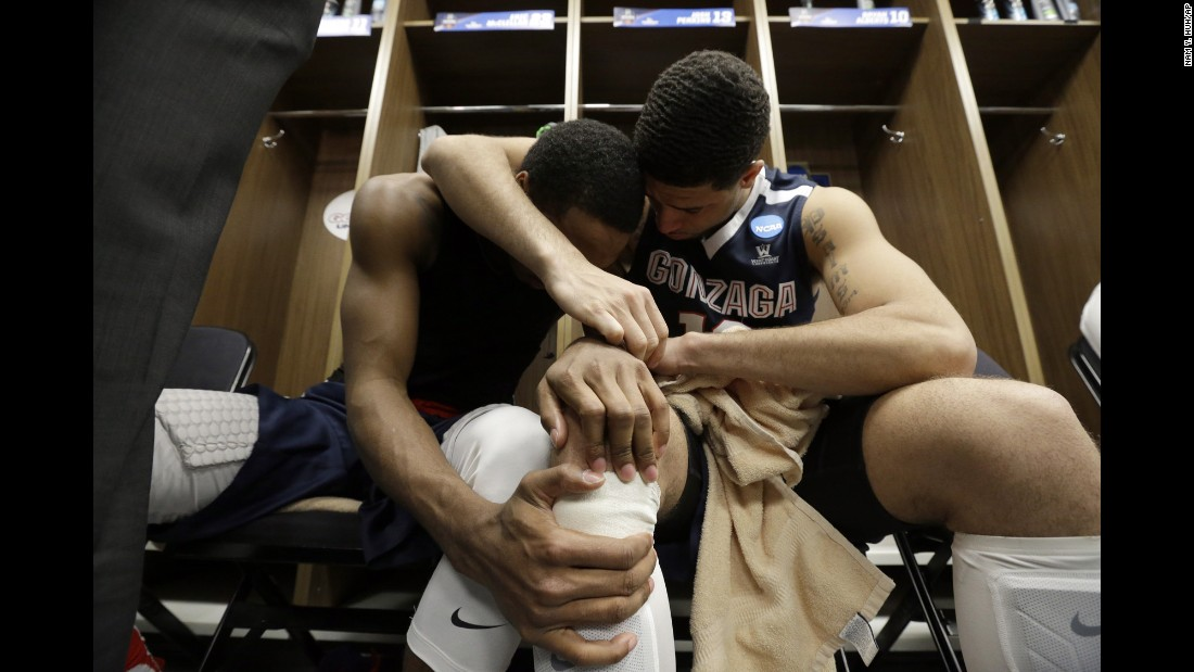 Gonzaga's Eric McClellan, left, and Josh Perkins embrace in the locker room after losing to Syracuse in the NCAA Tournament's Sweet 16 on Friday, March 25.