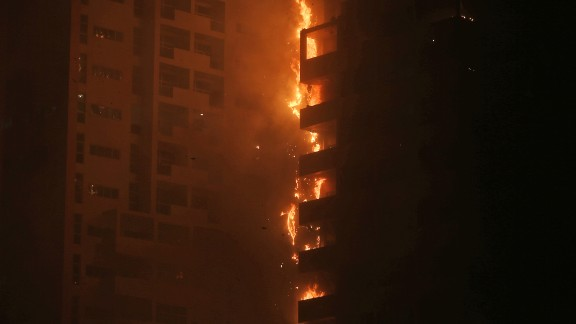 Fire and smoke billow from a high-rise building in Ajman, United Arab Emirates, early Tuesday.