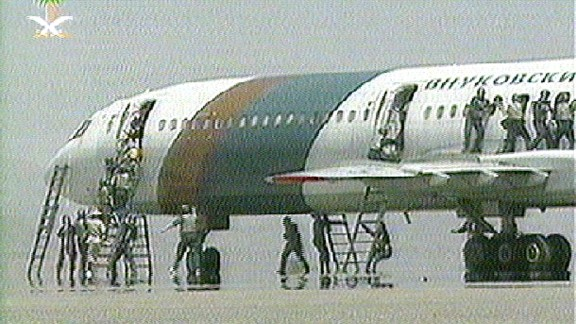 Saudi forces storm a hijacked Russian airliner at Medina airport in March 2001. Two people, including a flight attendant, and a hijacker were killed during the raid to liberate the aircraft, which was commandeered by three Chechen hijackers.