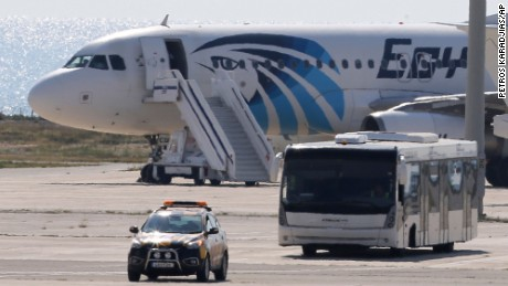 A bus carrying some passengers from the hijacked EgyptAir aircraft as it landed at Larnaca airport Tuesday, March 29, 2016. The EgyptAir plane was hijacked on Tuesday while flying from the Egyptian Mediterranean coastal city of Alexandria to the capital, Cairo, and later landed in Cyprus where some of the women and children were allowed to get off the aircraft, according to Egyptian and Cypriot officials. (AP Photo/Petros Karadjias)