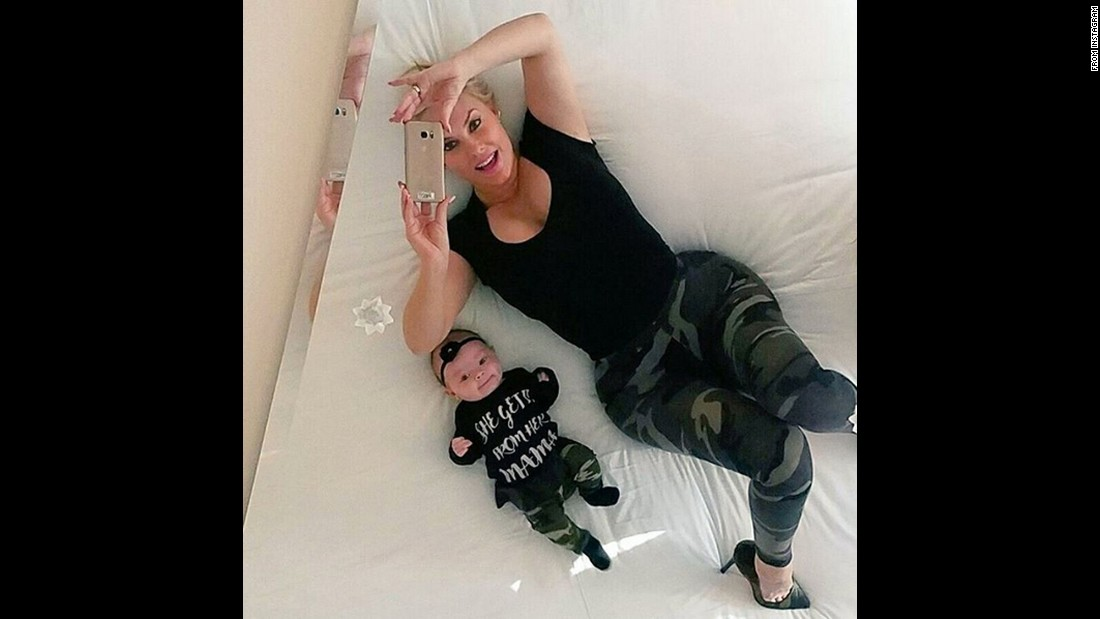 "Model Coco takes a selfie with her daughter, Chanel, on Saturday, March 26. ""Chanel & I having fun with the mirror above our bed,"" <a href=""https://www.instagram.com/p/BDcG-NoBQ5-/"" target=""_blank"">she said on Instagram.</a> ""I need one of these at home..LOL #Twinsies."""