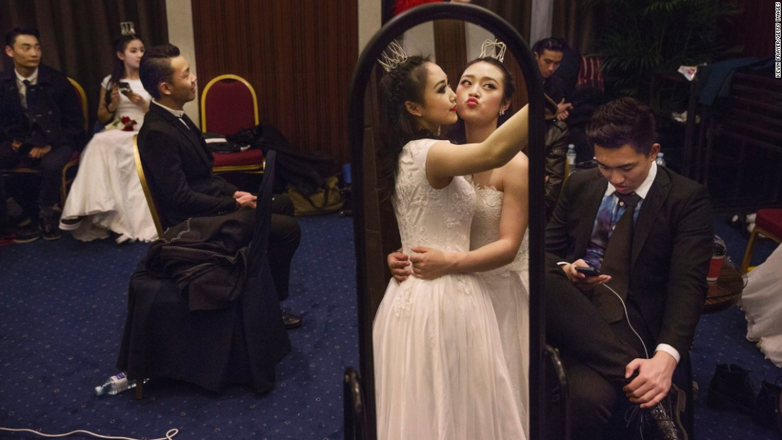 Debutantes from a local academy get ready for the Vienna Ball in Beijing on Saturday, March 19.