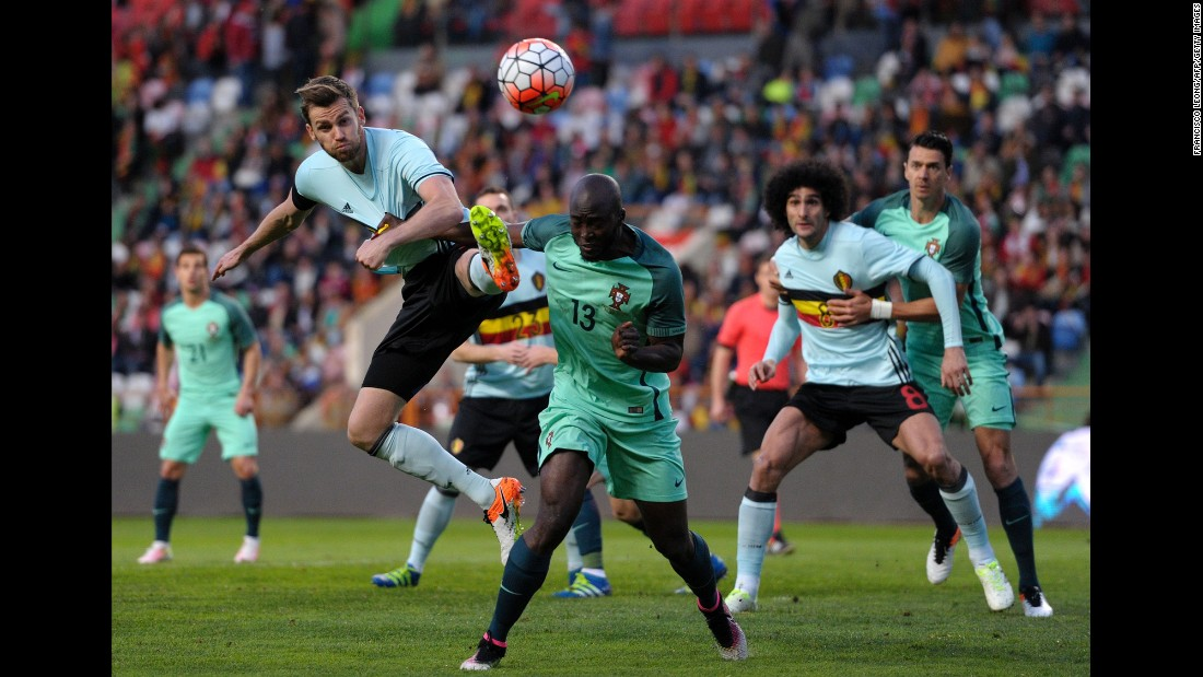 Belgian defender Nicolas Lombaerts, left, competes for a ball with Portugal's Danilo Pereira. Portugal won the match 2-1.