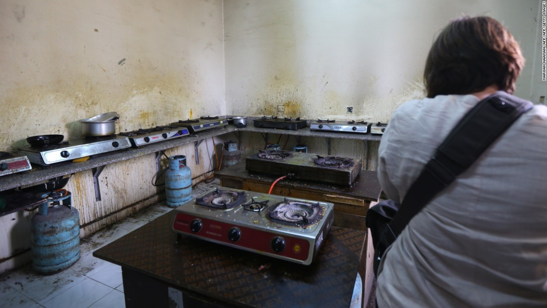 Here, a reporter takes a picture of a squalid kitchen at a camp housing foreign workers in Doha in May 2015. The Qatari government has announced new projects to provide better accommodation.