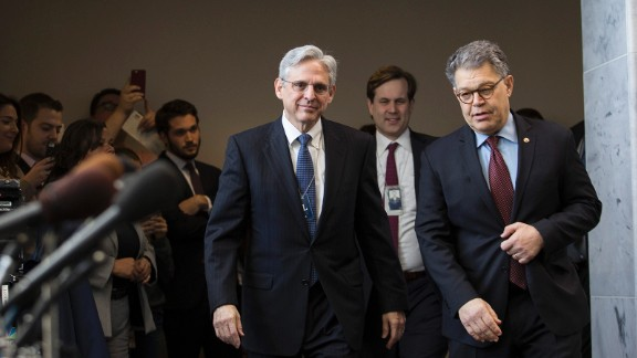 Supreme Court nominee Merrick Garland walks with Sen. Al Franken (D-MN)  as they head to a meeting in Franken's office on Capitol Hill, March 30, 2016 in Washington, DC.
