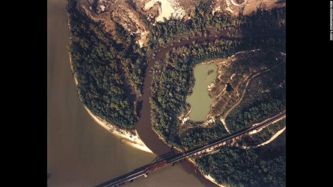 "The <a href=""https://cumulis.epa.gov/supercpad/cursites/csitinfo.cfm?id=0602488"" target=""_blank"">Sikes Disposal Pits</a> and the San Jacinto River are photographed near Crosby, Texas, in 1985. From 1955 to 1968, an illegal open dump operated on site, according to the EPA."